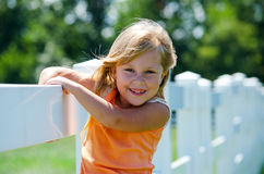 Smiling child on white fence Stock Photography
