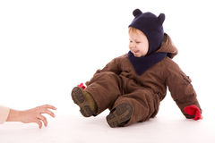 Smiling child in winter clothes Stock Photo