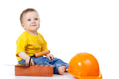 Smiling Child With Hard Hat And Construction Tools Stock Photo