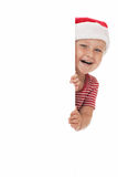 Smiling child with xmas hat Stock Images