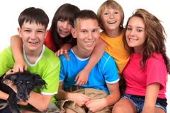 Smiling children. Five bright, smiling, happy children and a dog stock images
