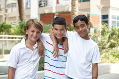 Smiling children . Portrait of three smiling handsome children of different races in outdoor stock photos