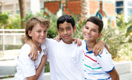 Smiling children . Portrait of three smiling handsome children of different races in outdoor Royalty Free Stock Image