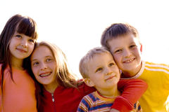 Smiling Children. A happy, smiling group of children in bright sunshine royalty free stock images