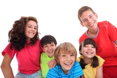 Smiling children. A group of smiling children and teenagers. White background stock photography