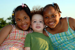Smiling children. A group of three smiling multi ethnic group children outdoors stock image