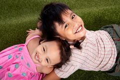 Smiling children. Having fun on the park royalty free stock photo