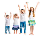 Smiling children with arms up. Isolated on white background royalty free stock image
