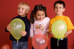 Smiling children with ballons Stock Photo