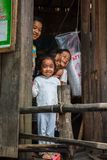 Smiling children in a Cambodian fishing village. SIHANOUKVILLE, CAMBODIA - 7/20/2015: A group of children smile and laugh from their home in a fishing village Stock Photography