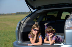 Smiling children in car Stock Photo