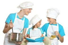 Smiling children in chef uniforms Royalty Free Stock Photo
