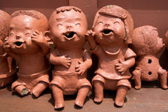 Smiling Children Clay Dolls Work Royalty Free Stock Images