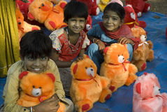 Smiling children- Doll sellers family Royalty Free Stock Images