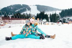 Smiling children enjoying winter vacations in mountains . Ski, Sun, Snow and fun royalty free stock photography