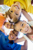 Smiling children forming a huddle in circle Stock Photo