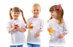 Smiling children with a glass of juice Royalty Free Stock Images