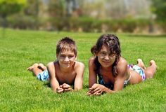 Smiling children on green grass Stock Photography