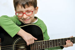 Smiling children and guitar Royalty Free Stock Images