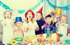 Smiling children having party friend's birthday Stock Images