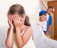 Smiling children hiding from girl Royalty Free Stock Photo