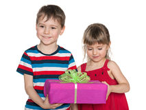 Smiling children hold a gift box Royalty Free Stock Photo
