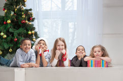 Smiling Children holding Christmas gifts Stock Photo