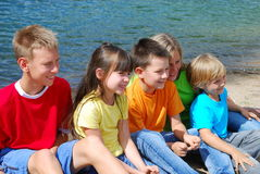 Smiling Children By A Lake Royalty Free Stock Photo