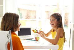 Smiling children learn at school desk royalty free stock photos