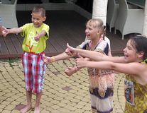 Smiling children make thumbs up outdoor, Sochi, Russia. Smiling children make thumbs up in summer outdoor, Sochi, Russia Stock Photos