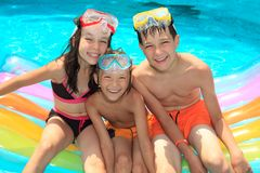 Smiling children in pool Stock Image