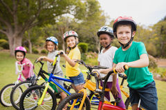 Smiling children posing with bikes Royalty Free Stock Photos