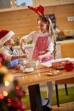 Smiling children preparing Christmas cookies Royalty Free Stock Image