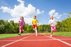 Smiling children running marathon together. Smiling children running marathon outside in summer stock photos