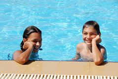 Smiling children in swimming pool royalty free stock photos