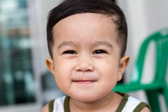 Smiling children. For Thailand nAsian male kid face closeup Stock Photo