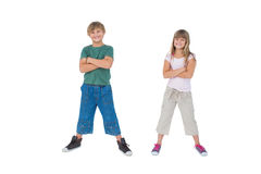 Smiling children with their arms crossed Stock Image