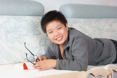 Smiling Chinese boy Stock Images