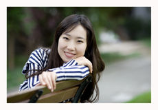A smiling chinese girl Stock Photography