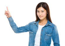 Smiling chinese girl pointing away Stock Photos