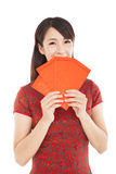 Smiling chinese woman holding red bag for luck Stock Image