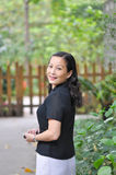 A smiling chinese woman Royalty Free Stock Photos