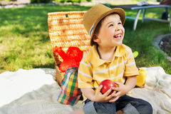Smiling chlid holding juicy apple Royalty Free Stock Image