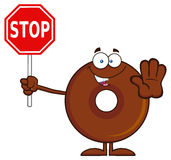 Smiling Chocolate Donut Cartoon Character Holding A Stop Sign Stock Photo