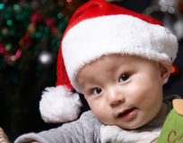 Smiling christmas baby. Smiling baby in a christmas hat Stock Photos
