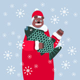 Smiling Christmas bear with big fish royalty free stock photo
