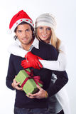 Smiling christmas couple hugged Stock Photos