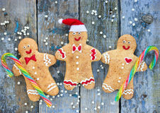 Smiling christmas gingerbread man. On wooden background Royalty Free Stock Image