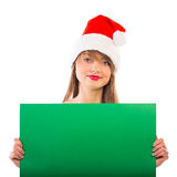 Smiling christmas girl with green placard on white Royalty Free Stock Photo