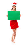 Smiling christmas girl with green placard on white Stock Photo